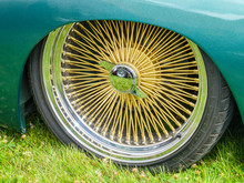 Low Profile Tires And Gold Colored Spokes Rims