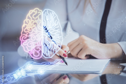 Obraz Multi exposure of woman's writing hand on background with brain hud. Concept of learning. - fototapety do salonu