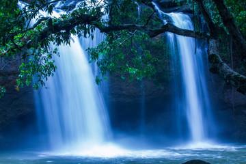 Panel Szklany Wodospad Tropical waterfall under the moonlight.
