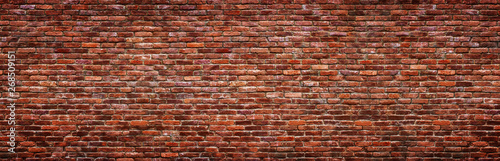 Poster Brick wall Antique brick wall, panoramic view. Grunge stone texture.