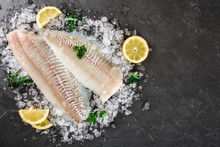 Fresh Raw Fillet White Fish Pangasius With Spices On Ice Over Dark Stone Background.  Seafood, Top View, Flat Lay, Copy Space