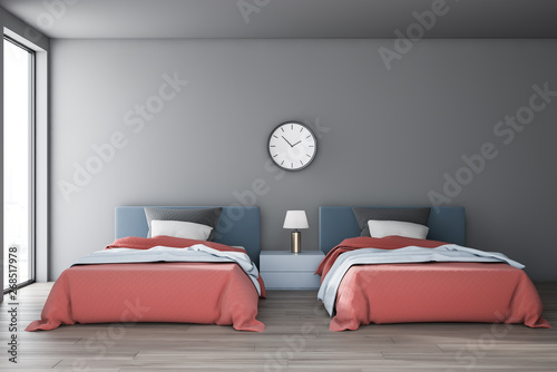 Gray bedroom interior with two beds and clock - 268517978