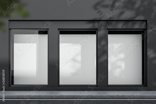 Fotografia Gray building exterior with mock up posters
