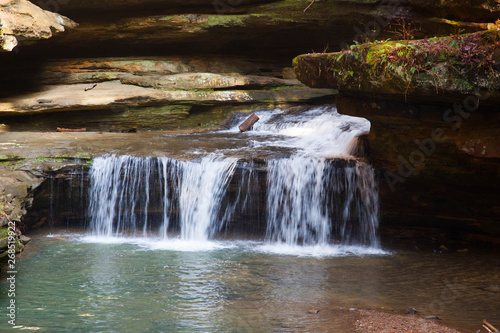 Waterfall outdoors with a stream and rocks