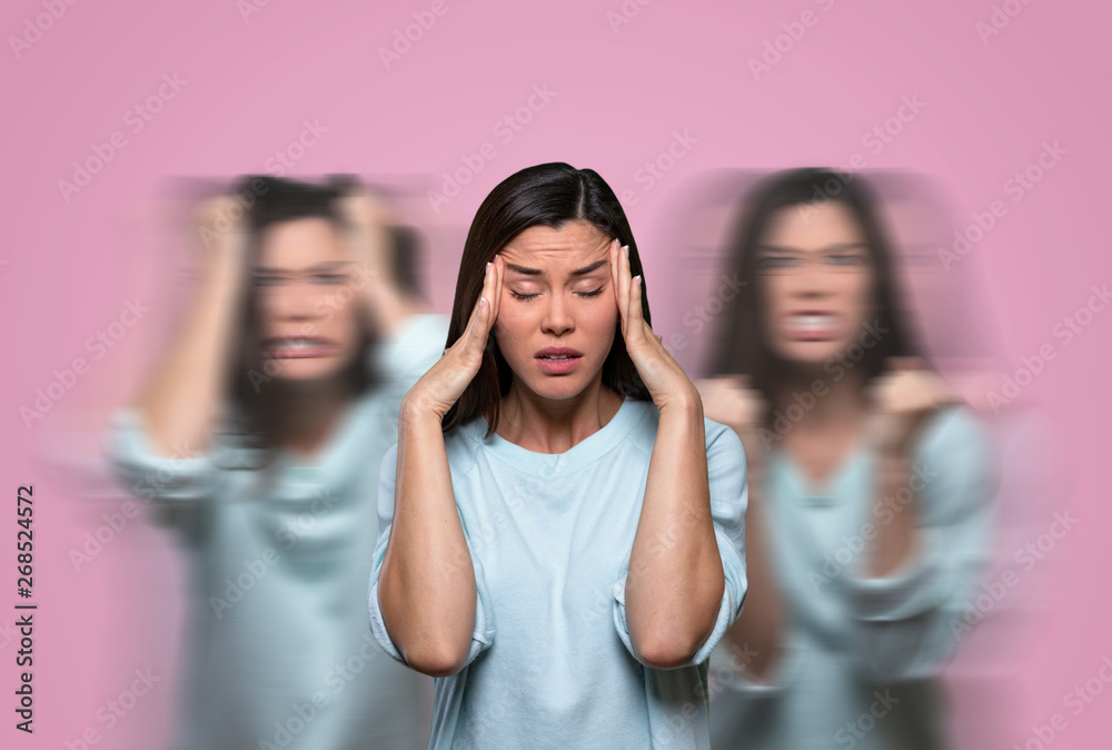 Fototapeta Female suffering from low self esteem, anxiety, anger issues, inner critical voices and negativity from insecure thoughts