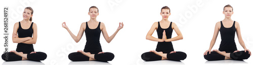 Young woman sitting cross-legged and doing yoga