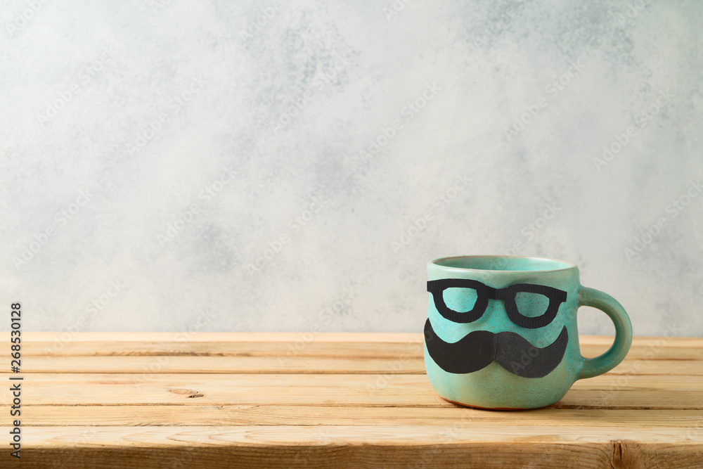 Fototapety, obrazy: Happy Father's day concept with cute funny coffee mug over wooden background