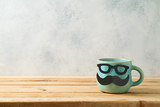 Happy Father's day concept with cute funny coffee mug over wooden background - 268530128