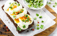 Rye Bread Sandwich With Boiled Egg, Cheese, Freshly Ground Pepper And Daikon Or Radish Sprouts. Delicious Gourmet Breakfast. Selective Focus