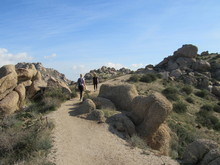 View Of A Trail With Hikers On The Path To Tom's Thumb In The McDowell Mountains In The Sonoran Desert Near Scottsdale, Arizona