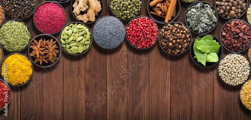 set  European seasonings on  wooden table. Background of spices and herbs for food labels
