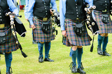 Bagpipers Wearing Kilts Marchi...
