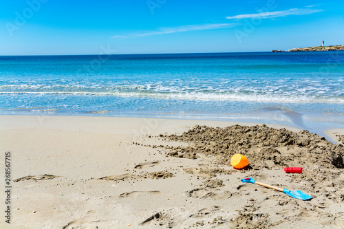 Printed kitchen splashbacks Light blue Crystal clear blue Mediterranean sea water on St.Croix Martigues beach and kids beach toys, Provence, France