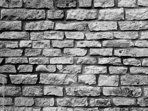 Papiers peints Cailloux Black grey brick old stone wall texture background