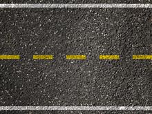 Yellow Line On Asphalt Road Background