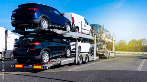 Photo  New cars on truck . Transportation New Cars .