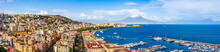 Naples City And Port With Mount Vesuvius On The Horizon Seen From The Hills Of Posilipo. SSeaside Landscape Of The City Harbor And Golf On The Tyrrhenian Sea