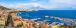 Leinwandbild Motiv Naples city and port with Mount Vesuvius on the horizon seen from the hills of Posilipo. Seaside landscape of the city harbor and golf on the Tyrrhenian Sea