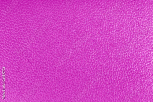 Purple leather background texture close up