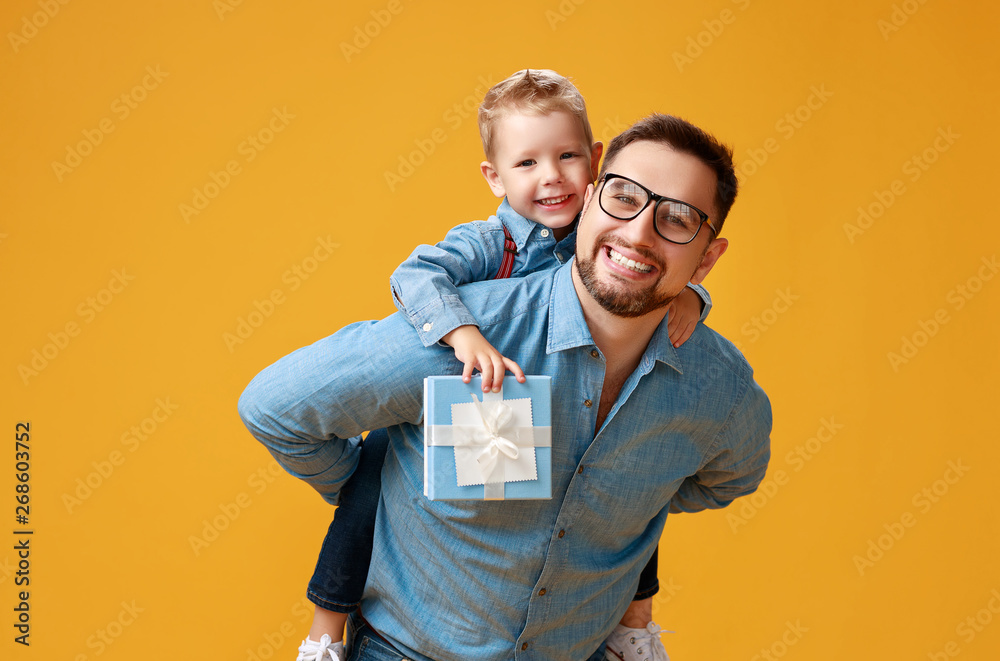 Fototapety, obrazy: happy father's day! cute dad and son hugging on yellow background