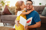Father's day. Happy family daughter hugging dad and laughs - 268603965