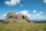 Lovely Spring landscape image of Haytor in Dartmoor National Park in Devon England on lovely sunny Spring day with unidentified person for scale - 268616164