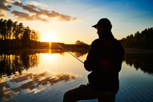 Sunset Fishing. Fisher With Sp...