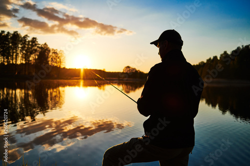 Poster de jardin Peche sunset fishing. fisher with spinning rod