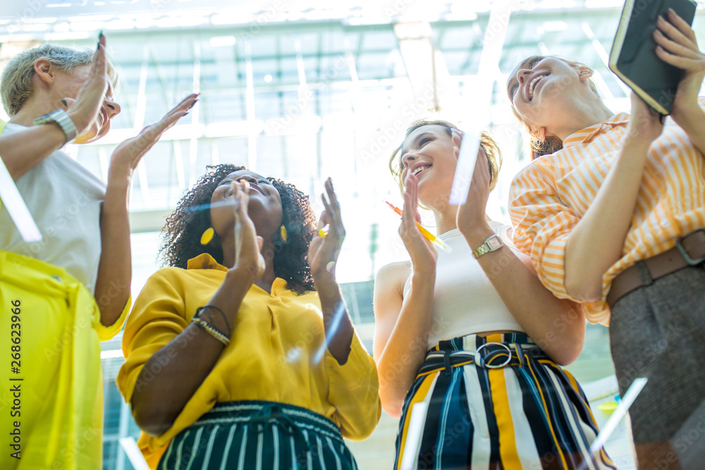 Fototapety, obrazy: Happy group of talented successful young businesswomen, designers clapping in office, low view. good job, good presentation, winers are celebrating their victory