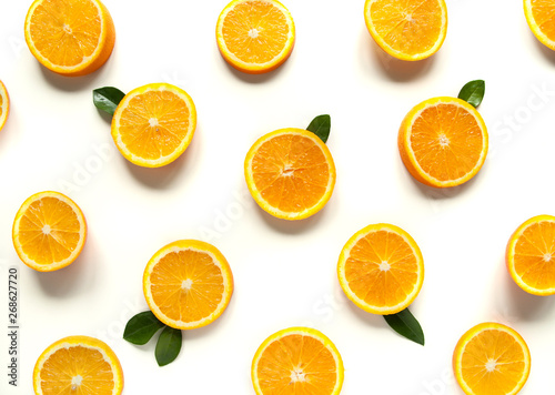Round orange slices on a white background. Citrus tropical fruit background. Bright food. Dietary vitamin nutrition. A lot of vitamin C. - 268627720