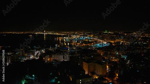 Photo Beautiful night panorama aerial view of skyline of city Algiers, Algeria