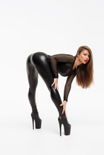 Erotic Woman In Leather Pants And Heels