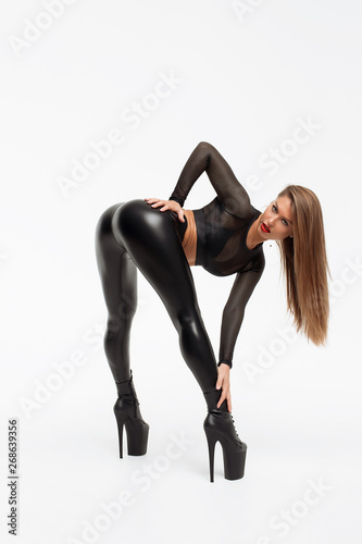 Leinwand Poster Erotic woman in leather pants and heels