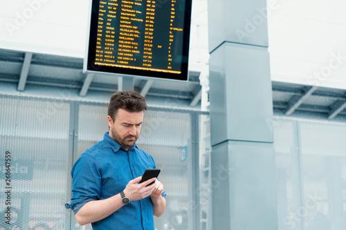Fototapeta Portrait of caucasian male in railway train station obraz