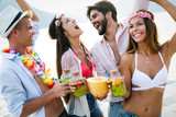 Group of happy friends partying and having fun on summer vacation - 268650329