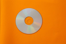 Mini Compact Disc Isolated Against Orange Background