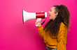 canvas print picture - Teenager girl over pink wall shouting through a megaphone