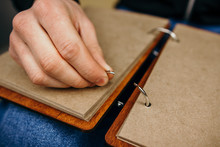 The Man Opened The Metal Split Ring In The Notebook. Open Ring Binder. Replacing Pages In A Notebook. Ring Mechanism In A Notebook. Open Ring For Notebook