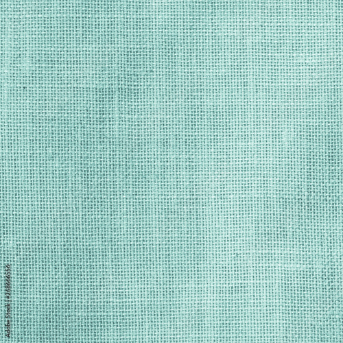 Obraz na plátně  Hessian sackcloth woven texture pattern background in light cyan turquoise green