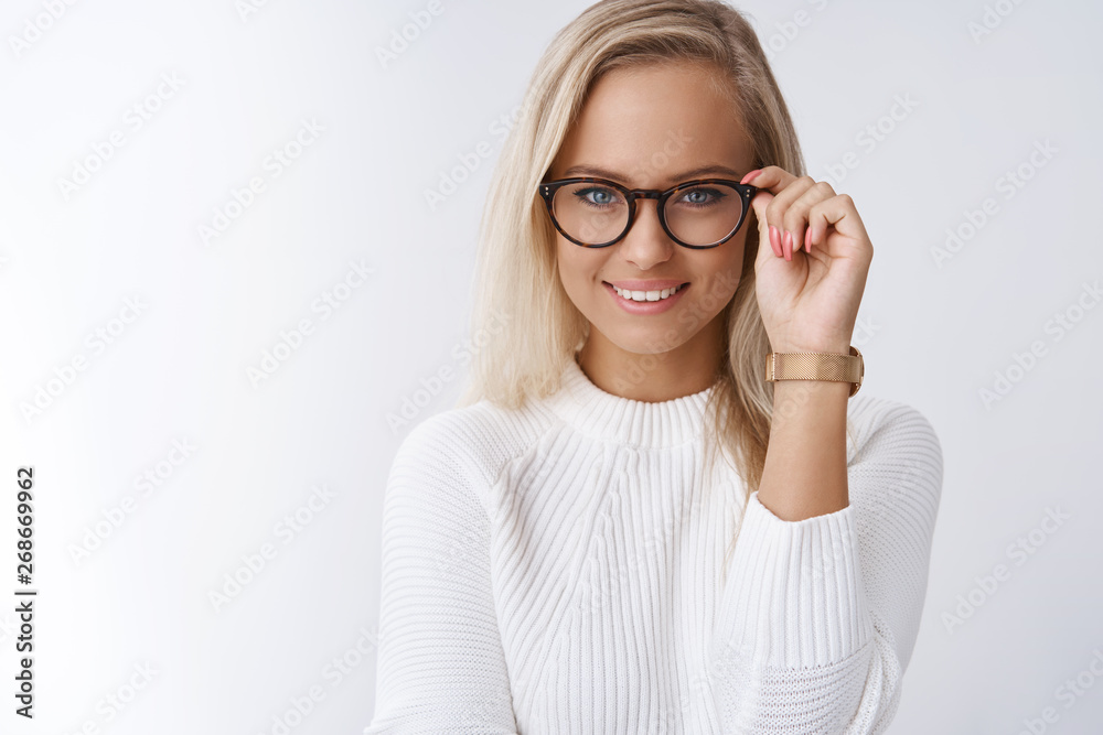 Fototapety, obrazy: Charming female wants help pick glasses. Portrait of elegant and sensual young blond woman with daring and cheeky smile looking confident touching frames as posing against white background