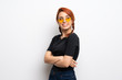 Leinwandbild Motiv Young redhead woman over white wall with arms crossed and happy