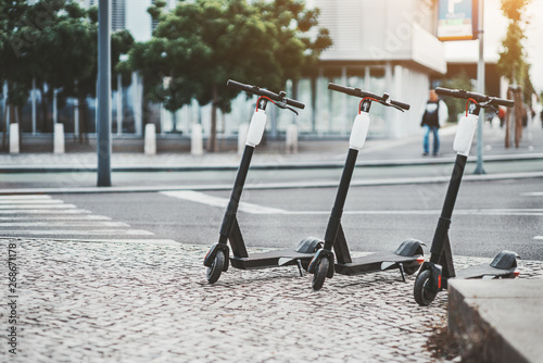 Electric urban transportation: three modern electric readies to ride scooter bik Canvas Print