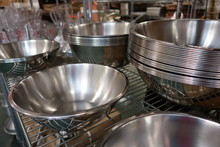 Several Stacks Of Empty Stainless Steel Restaurant Service Bowls