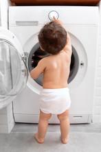 Baby Pushing Buttons Of Washing Machine
