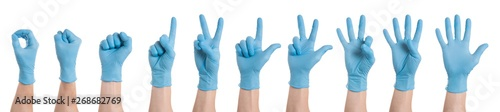 Right hand wearing latex surgical glove with gesture number from zero to five on wite background Wallpaper Mural