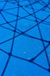 canvas print picture - Blue surface with rope shadows.