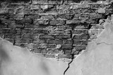 Old brick wall with fallen off plaster. Background of crack brick wall texture