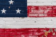 Peeling American Flag On Brick Wall