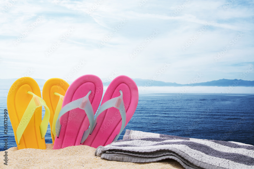 Leinwandbild Motiv - carballo : footwear and towel in the landscape of the beach, holidays and summer