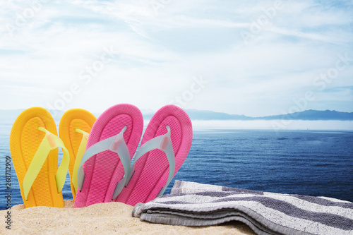 Tuinposter Hoogte schaal footwear and towel in the landscape of the beach, holidays and summer